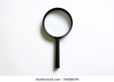 Magnifying glass isolated on white background. Concept of investigation,exploration,searching,finding,checking,inspecting data or information. Copy space or for blog title and header.