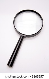 Magnifying glass isolated over white