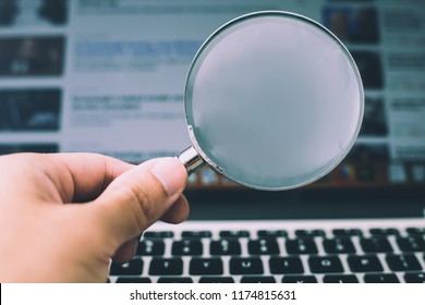Magnifying glass with the laptop background.