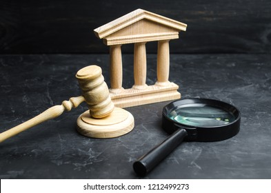 Magnifying glass lies near the courthouse. Lawsuits, verdict and bills. Constitutional Court. Human rights obstruction, power control and transparency, anti-corruption. Selective focus