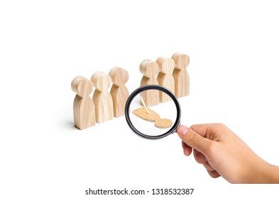 Magnifying glass is looking at a fake person falls out of the line of human figures. presence, concealment of absence. Unreliable person, late, failed. Low discipline, disobedience, breaking the rules