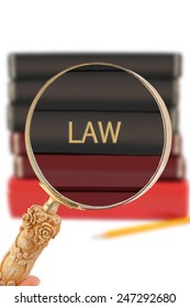 Magnifying glass or loop looking on an educational university subject - Law
