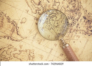 Magnifying glass, maps, finance, business, tourism, exploration