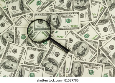 magnifying glass on a background American dollar