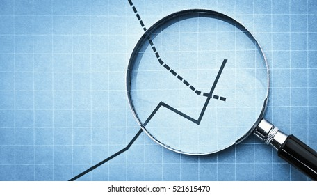 magnifying glass on business graph