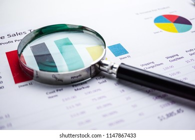 Magnifying glass on chart and graph paper. Financial development, Banking Account, Statistics, Investment Analytic research data economy concept.