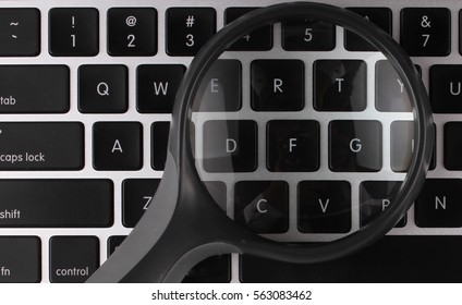 Magnifying glass on laptop computer