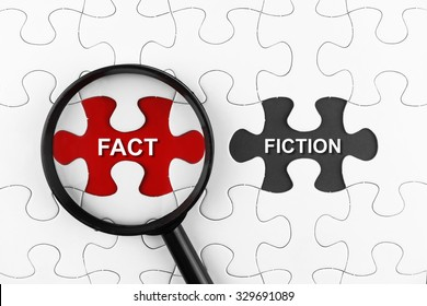 Magnifying glass on missing puzzle with a word Fact and Fiction
