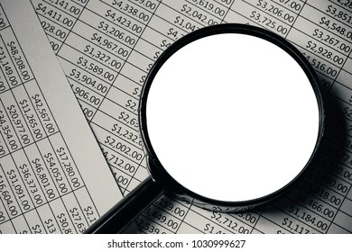 Magnifying glass on paper money dollars report with white empty copy space.
