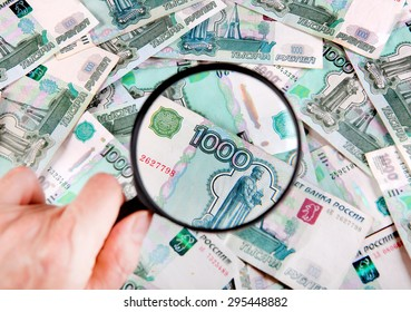 Magnifying Glass on the Russian Currency Background