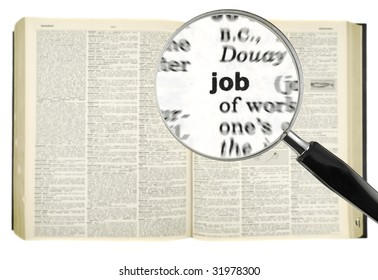 A magnifying glass on the word JOB on a dictionary. Isolated on white.