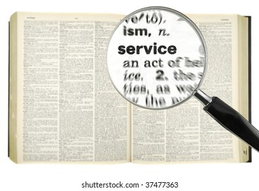 A magnifying glass on the word SERVICE on a dictionary. Isolated on white.