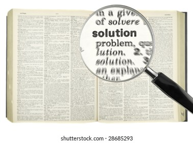 A magnifying glass on the word SOLUTION on a dictionary.