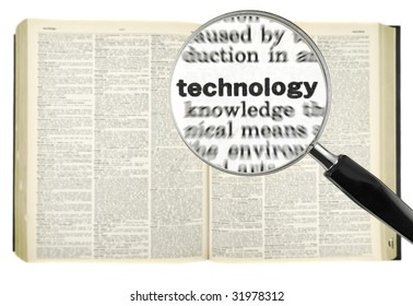 A magnifying glass on the word TECHNOLOGY on a dictionary. Isolated on white.