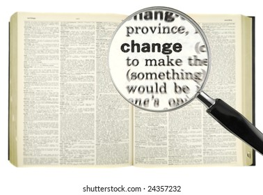 A magnifying glass on the world CHANGE on a dictionary.