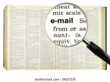 A magnifying glass on the world email on a dictionary.
