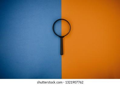 magnifying glass magnifying glass orange-blue background
