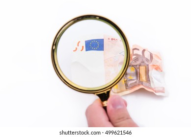 Magnifying glass over a logo of fifty euros shriveled on white background