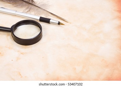 magnifying glass and pen at background