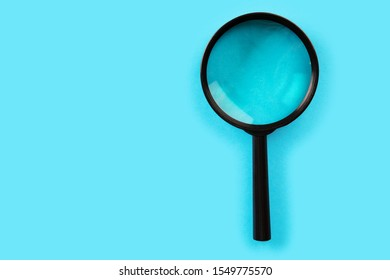 Magnifying glass. Search tool. blue background