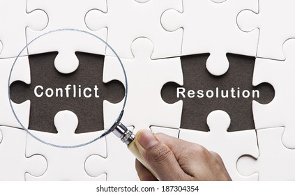 "Magnifying glass searching missing puzzle peace ""Conflict Resolution"""