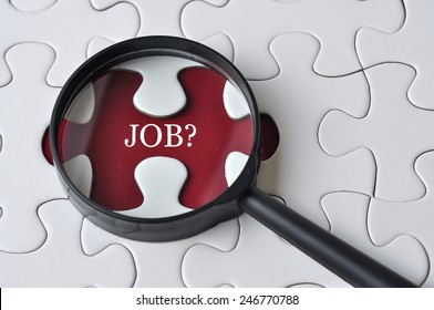 """Magnifying glass searching missing puzzle peace """"JOB"""""""