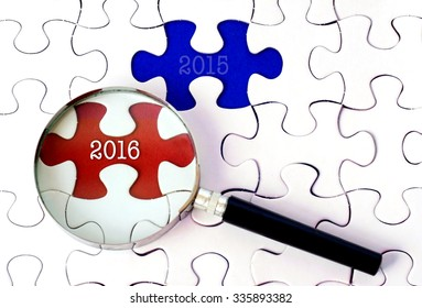 Magnifying Glass Searching Missing Puzzle Find 2016 And 2015.