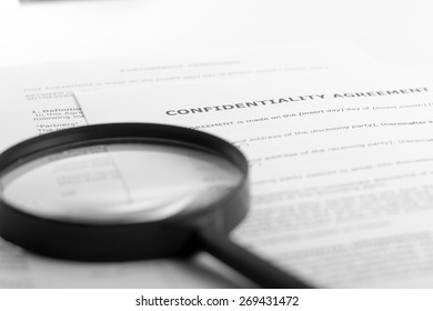 Magnifying glass. Signing documents. Partnership agreement. Search information.