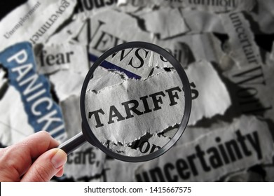 Magnifying glass with tariff related newspaper headlines
