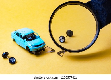 with a magnifying glass view of the broken car on a yellow background, after the accident