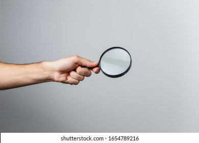 magnifying glass in woman hand