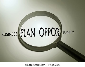 Magnifying glass with the word business plan opportunity. Searching business plan opportunity