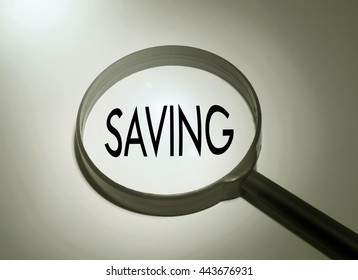 Magnifying glass with the word saving. Searching saving