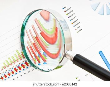 magnifying glass and the working paper with a diagram