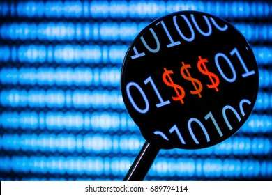 Magnifying glass zooming the red dollar sign. Computer screen with blurry binary code all around.