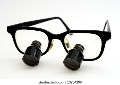 9fe8d211c27 Surgeon Looks Over Magnifying Glasses Stock Photo (Edit Now ...