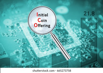 Magnifying lens over background with text Initial coin offering, with the financial data visible in the background.