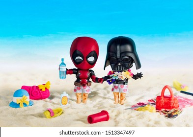 """MAGNITOGORSK, RUSSIA - August 26, 2019: Darth Vader and Deadpool movie figurines on vacantion, which represents character of the movies and computer games series """"Star Wars"""" and """"Deadpool"""".  Illustrat"""