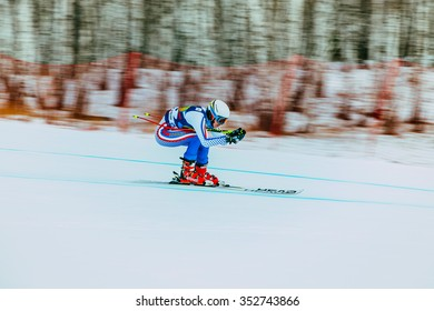 Magnitogorsk, Russia -  December 13, 2015: young female athlete in competition. background blur effect during Russian Cup in alpine skiing
