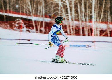 Magnitogorsk, Russia -  December 13, 2015: young girl athlete finish after downhill from mountain during Russian Cup in alpine skiing