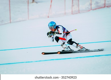 Magnitogorsk, Russia -  December 13, 2015: downhill young man athlete skiing to competition Russian Cup in alpine skiing