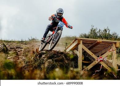 Magnitogorsk, Russia - July 22, 2017: man rider drops mountain biking during National championship downhill