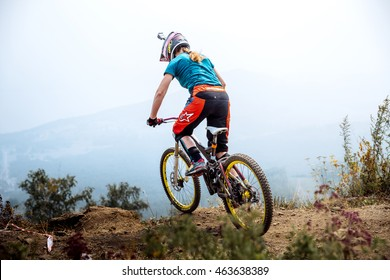 Magnitogorsk, Russia - July 23, 2016: girl extreme athlete on bike at top of mountain during National championship downhill
