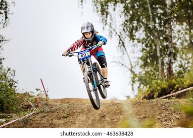Magnitogorsk, Russia - July 23, 2016: jump over mountain girls extreme athlete bike during National championship downhill