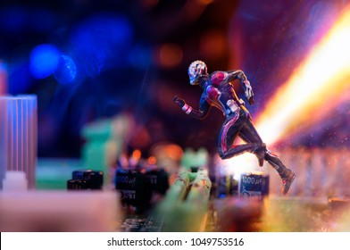 MAGNITOGORSK, RUSSIA - March 12, 2018: A figurine of running Ant-Man hero. This is the name of a fictional character appearing in comic books published by Marvel. Illustrative editorial.