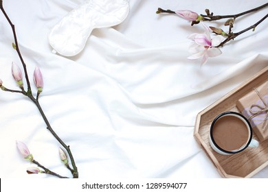 Magnolia flower flat lay morning in bed concept composition. Top view