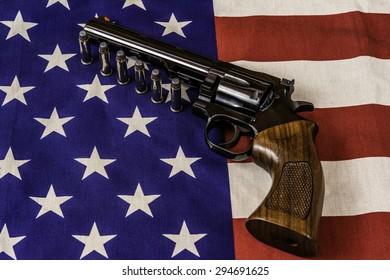 magnum handgun and bullets on american flag
