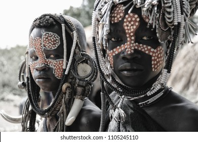 Mago National Park, Ethiopia – August 2017: Children of the Mursi Tribe look fiercely into the lens as they are being photographed.