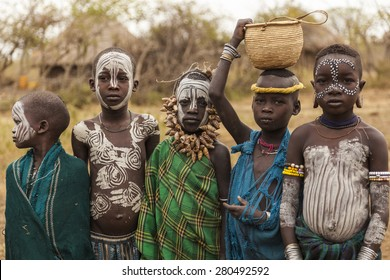 MAGO NATIONAL PARK, OMO VALLEY, ETHIOPIA - JANUARY 01, 2014: Unidentified children from Mursi tribe in Mirobey village.