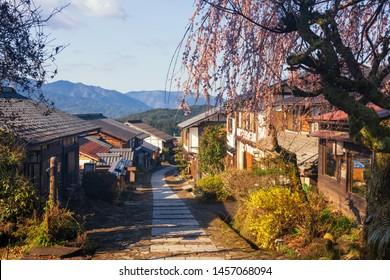 Magome juku post town of Nakasendo with cherry blossom or sakura in morning, Kiso valley in  Nakatsugawa, Gifu Prefecture, Japan. Famous travel landmark of preserved  old Japanese town.